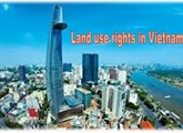 May an overseas Vietnamese acquire houses associated with land use rights in Vietnam ?